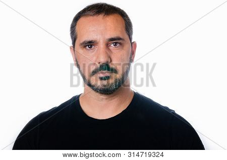 Portrait Of Serious Man On White Background