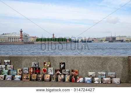 Saint Petersburg, Russia - May 25, 20197: Sale Of Paintings On The Embankment Of The Neva River. Vie
