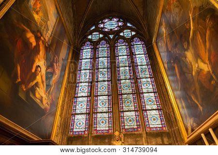 Paris, France - June 23, 2017: Stained Glass Window In The Notre-dame De Paris Church. Is A Medieval