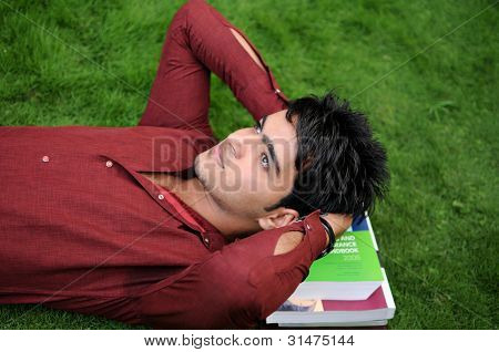 Closeup of a College Student with books.