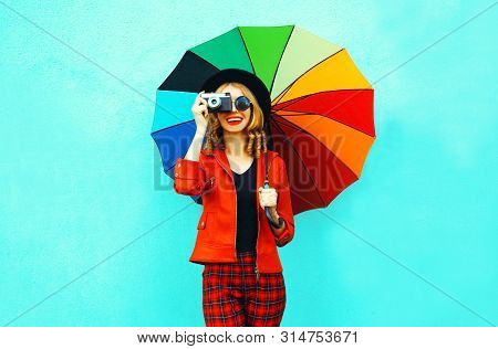 Happy Smiling Woman Holding Colorful Umbrella, Retro Camera Taking Picture In Red Jacket, Black Hat