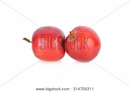 Fresh Pink Lady Apple With Stem On White Background