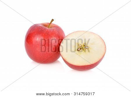 Whole And Half Cut Fresh Pink Lady Apple With Stem On White Background
