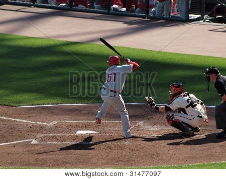 Phillies Carlos Ruiz Steps Forward To Hit Pitch With Catcher Buster Posey Squatting Ready To Catch