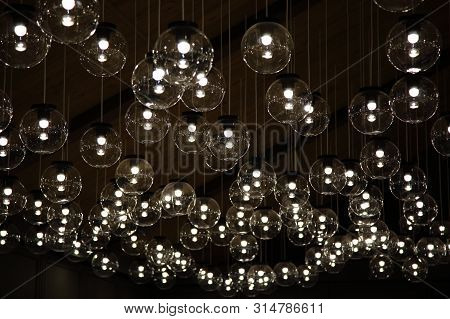 Original Luxury Decorative Lighting In The Restaurant. Round Lamps Hanging From The Ceiling In A Res