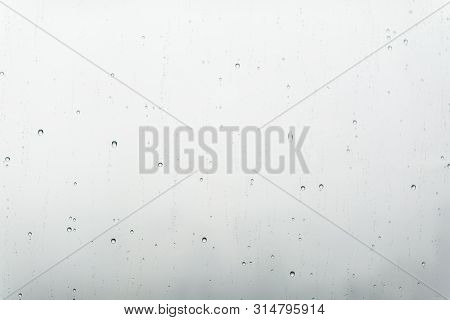 Water Drops On Glass Window In Grey Shades