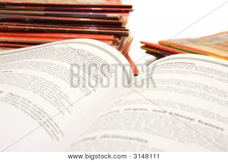 Book With Stack Of Magazines