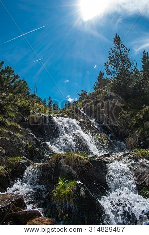 Landscape With Waterfall In The Mountains In Summer At Parc Natural Del Comapedrosa, Arinsal, Andorr