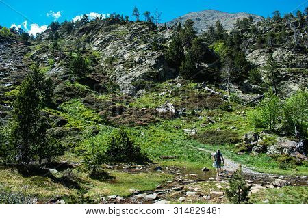 Hiking In Mountains In Summer At Parc Natural Del Comapedrosa, Andorra