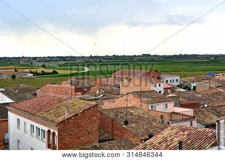 Catalonia, Bell Lloc Urgell Town; Typical Roofs And Cereal Fields