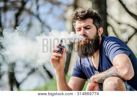 Health Safety And Addiction. Inhaling Vapor. Man Smoking E-cigarette. Bearded Brutal Male Smoking El