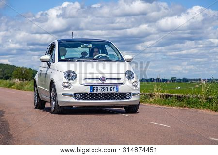France Lyon 2019-06-20 Closeup Front View Small Compact White Car Hatchback Fiat 500 On The Backgrou