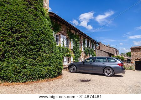 France Lyon 2019-06-20 People And European Station Wagon-type Cars Parked In The Courtyard Of Cozy O