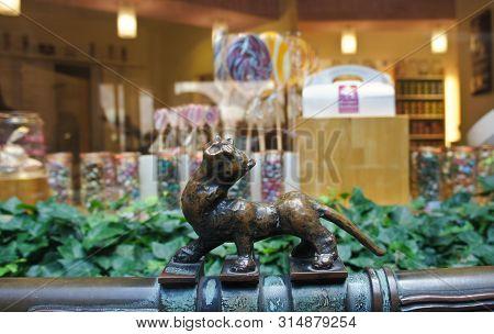 Bremen, Germany - 07 23 2015 - Shop Window Of Bremer Bonbon Manufaktur And Little Statue On Bottcher