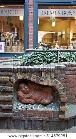Bremen, Germany - 07 23 2015 - Shop Window Of Bremer Bonbon Manufaktur And Wall Decor Sculpture On B