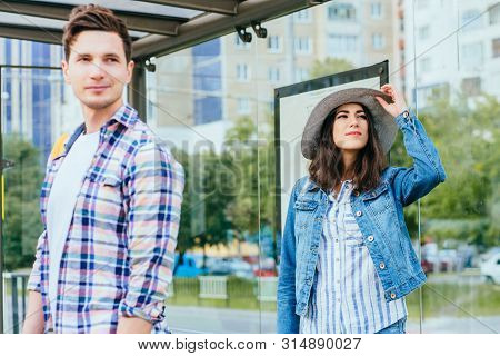 Guy At Bus Stop Looking At Girl Standing Next To Him, Waiting For Tram, Love At First Sight Feelings