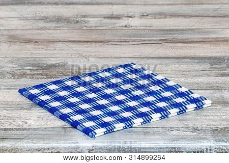 Empty Table Background. Closeup Of A Empty Blue And White Checkered Kitchen Cloth, Textile, Tableclo