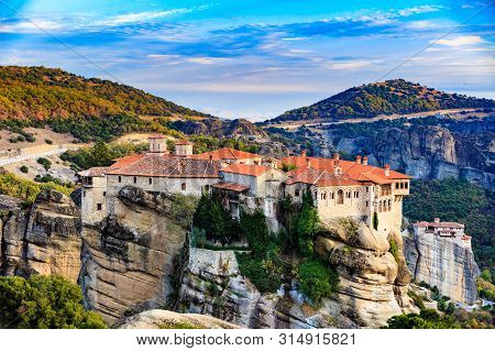 Holy Varlaam Monastery On Cliff In Meteora, Rousanou Nunnery In The Distance, Thessaly Greece. Greek