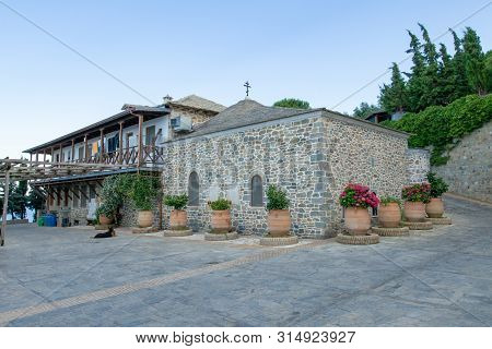 The Buildings Of The Monastery On Mount Athos, Decorated With Large Vases Of Flowers