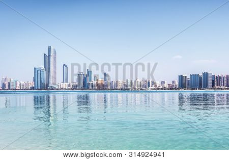 Abu Dhabi City View With Water And Blue Sky