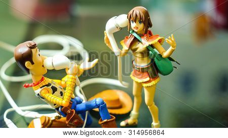 Songkhla, Thailand - November 24, 2018: Woody Listen To Music Girl.this Figure By Disney Pixar Inc.
