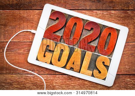 2020 goals banner - New Year resolution concept - text in vintage letterpress wood type printing blocks on a digital tablet
