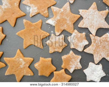 Raw Cutouts Of Stars Ginger Bread Cookies On Baking Sheet Ready For Oven