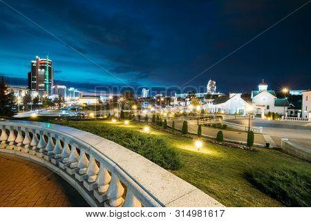 Minsk, Belarus. View Of Central District Nemiga, Pobediteley Avenue In Summer Evening Night Time.