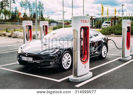 Tocksfors, Sweden- June 26, 2019: Black Color Tesla Model S 100d Car Parked At Charging Station. The