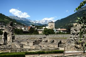 The Ancient Roman Remains Of The City Of Aosta And In The Background The Mont Blanc - Italy
