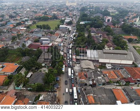 Traffic Jam On The Polluted Streets Of Bekasi. Has The Highest Number Of Motor Vehicles And The Traf