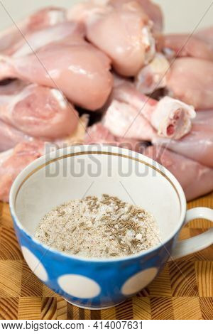 Spices Salt Pepper Cardamom Zira In A Jar On Background Of Chicken Meat.