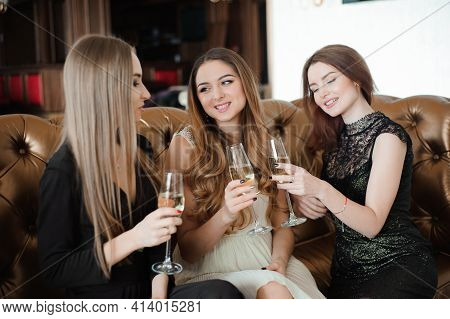 Holidays, Nightlife, Bachelorette Party And People Concept - Smiling Women With Champagne Glasses.
