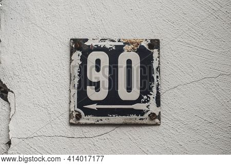 Weathered Grunge Square Metal Enamelled Plate Of Number Of Street Address With Number 90