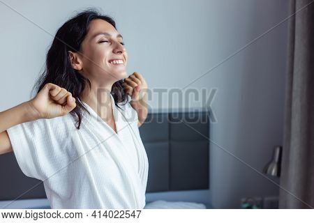 Beautiful Woman Waking Up On Her Bed At Bedroom Young Female Stretching And Smiling Overjoyed Beauty