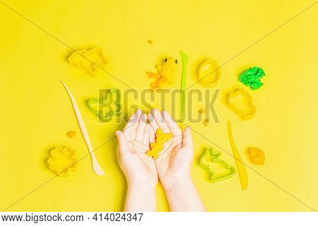Children Hands Playing With Colorful Modeling Clay On White Background