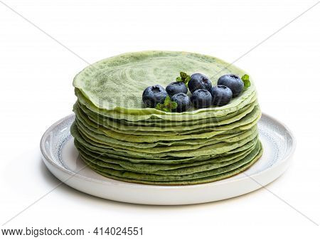 Green  Pancakes In Small Pan Isolated On White