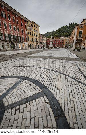 Cityscape. Carrara City Center: Piazza Alberica With The Commemorative Monument In The Center And Th