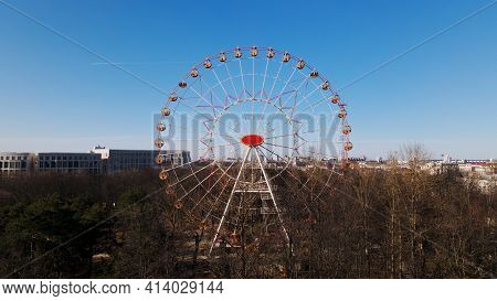 A Panoramic Shot Of A Spring City Park. The Ferris Wheel Is Visible.