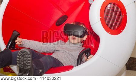 A Child Watches A 3d Movie With Virtual Reality Glasses In A Chair For Full Immersion In The Virtual
