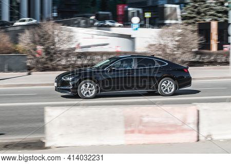 Moscow , Russia - March 2021: Hyundai Sonata 2020 On The City Road. Fast Moving Black Shiny Car On T
