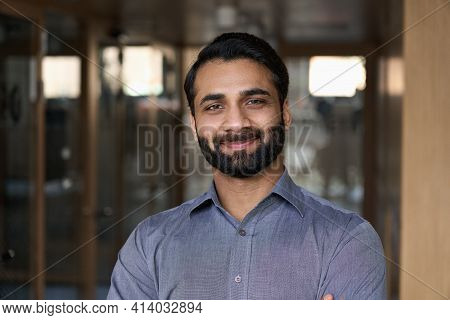 Portrait Of Young Happy Indian Business Man Executive Looking At Camera. Eastern Male Professional T