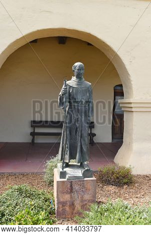 SOLVANG, CALIFORNIA - SEPTEMBER 21, 2016: Junipero Serra Statue Santa Ines Mission. Father Serra founded the first 9 of the 21 California Missions.