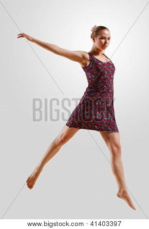 Girl in color dress dancing