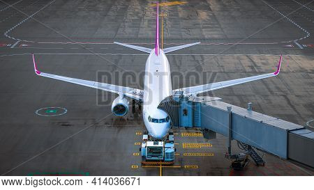Modern Airplane While Boarding At The Airport
