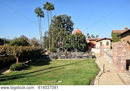 SAN JUAN CAPISTRANO, CALIFORNIA - 12 JAN 2017: Mission San Juan Capistrano Vegetable Gardens and Wine Vat area.