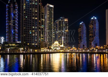 Dubai, United Arab Emirates - 05 December, 2018: Night View On Skyscrapers Of Dubai Marina, An Artif