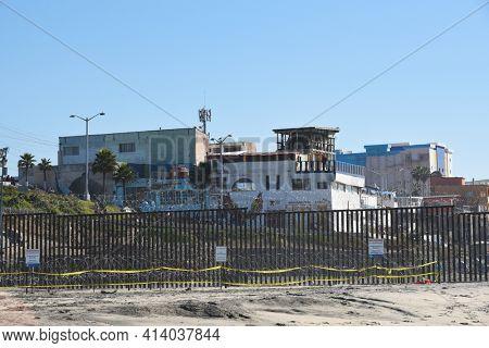 SAN YSIDRO, CALIFORNIA - NOVEMBER 26, 2018: The USA Mexico Border Wall seen from Imperial Beach looking towards Tijuana, Mexico and The Friendship Circle Bi-National Garden.