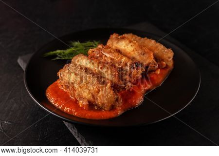 Freshly Cooked Buffalo Wings Closeup With Tomato Sauce And Tomatoes