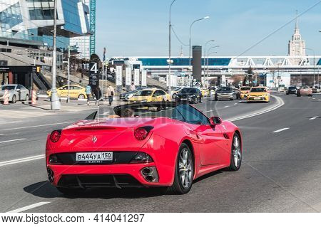 Moscow, Russia - March 2021: Rear View Of Red Ferrari California In The City Street. Rental Supercar